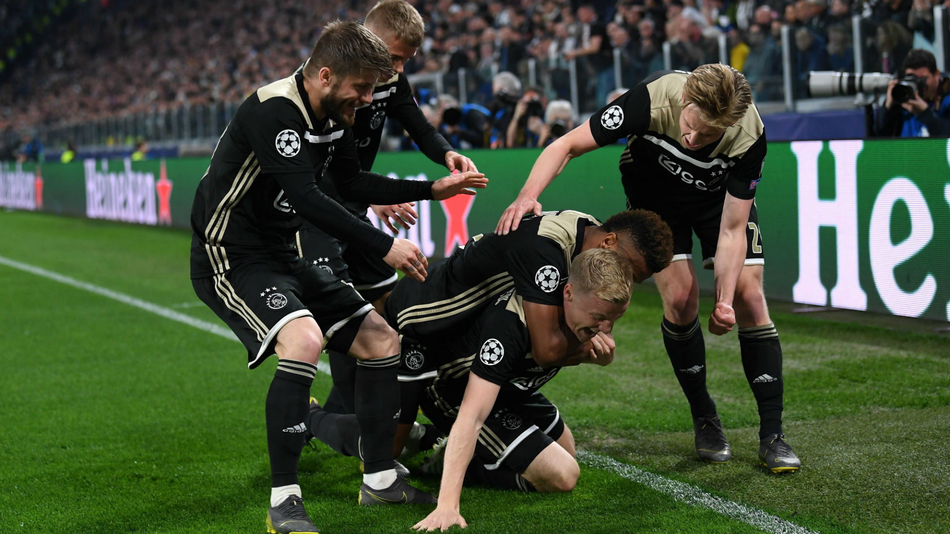 ajax celebrating win over juventus